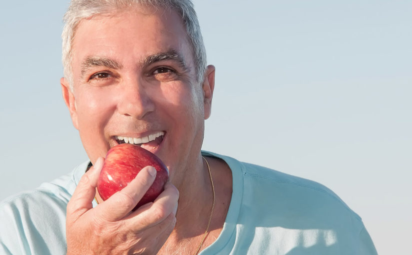 Implants vs Dentures: A Comparison